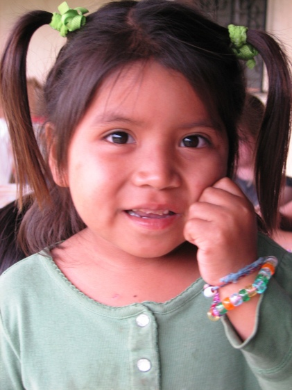 Showing off the bead bracelets she just made.