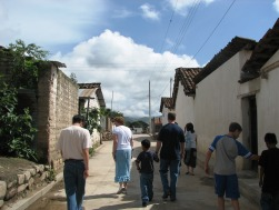 The team walking through the village streets to enjoy some bartering.