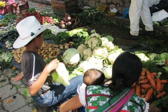 Vegetables for sale on tarps during Market Day.