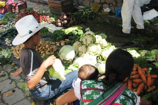Vegetables for sale on tarps during Market Day.