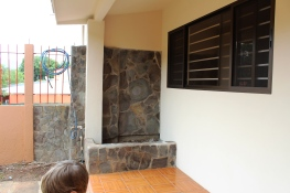 We were able to keep a bit of the garden box in front of the new kitchen wall. Now to decide: Flowers or Cherry Tomatoes?