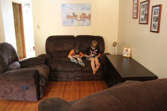 Living Room. Boys enjoying technology time and our comfy sofa. It's a snug fit, but we love it.